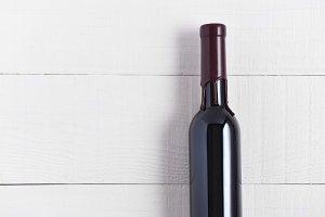 Single Bottle of Wine on a White Woo