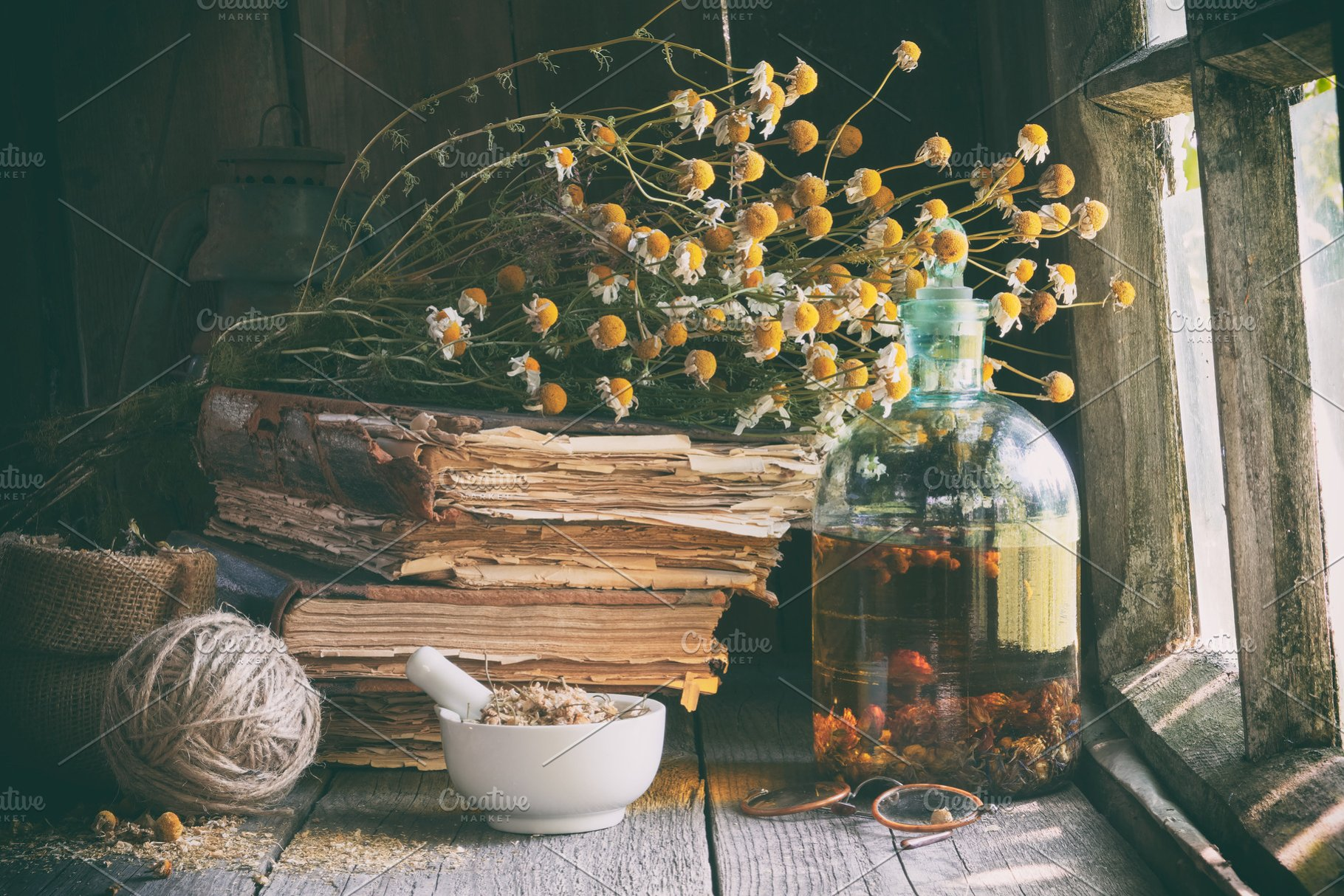 Mortar of herbs, infusion, old books