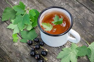 Cup of fruit tea with black currants