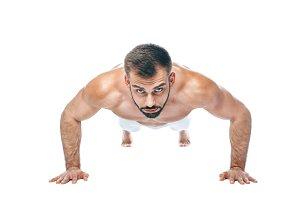 Push ups. bodybuilder posing