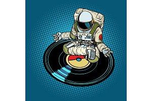 Astronaut man meditates to music