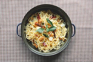 Homemade spaghetti on tablecloth