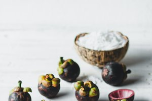 Natural Mangosteen On white wood