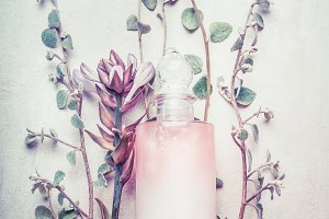 Cosmetic bottle with herbs