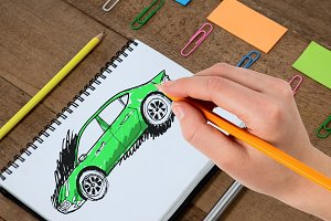 Sketch of car and hand drawing