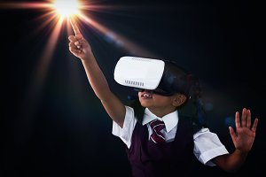 Schoolgirl using virtual reality