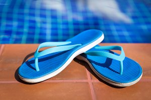 Beach slippers on border of swimming