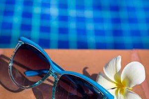 Blue sunglasses with  plumeri