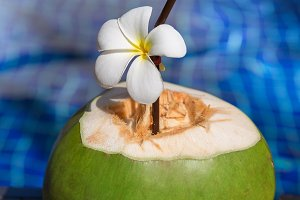 Fresh coconut juice with straw and
