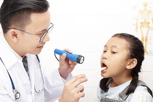 Doctor talking to young child and mo