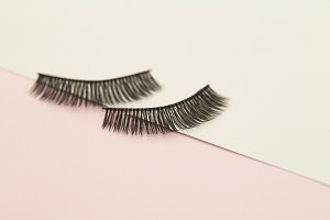 Eyelashes on pink and green paper