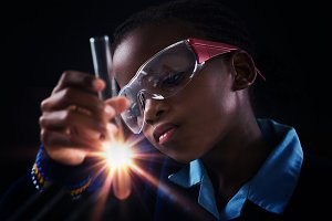 Girl doing a chemical experiment