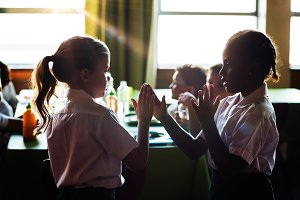Girls playing clapping game