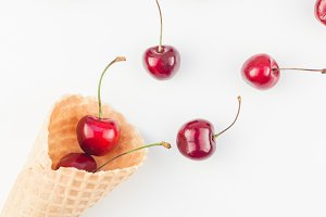 Ripe cherries in a waffle cone isola