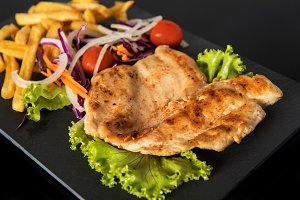 Juicy grilled chicken breast steak