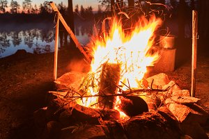 Fireplace in camping near lake at