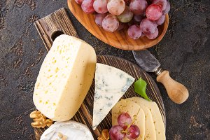 Cheese with nuts and grapes
