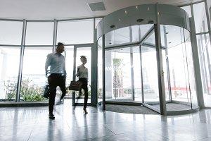 People walking in office entrance