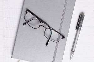 Sliver Journal with Glasses and Pen