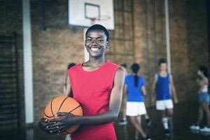 School boy holding a basketball