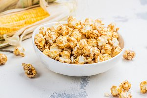 Caramel popcorn in a white bowl