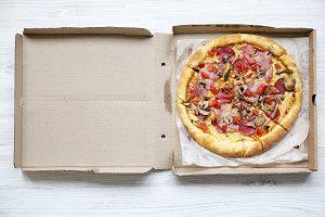 Fresh pizza in a cardboard box