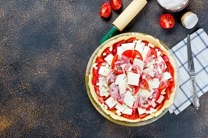 raw Greek pie with feta and tomatoes