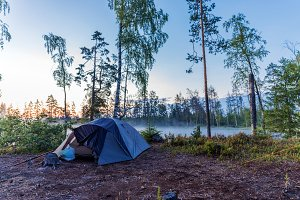 Camping tent near lake outdoors