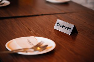 'Reserved' Sign on dining table in r