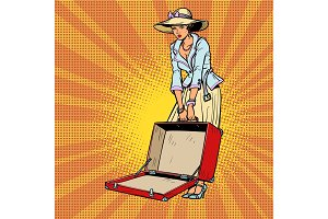 Woman with open suitcase