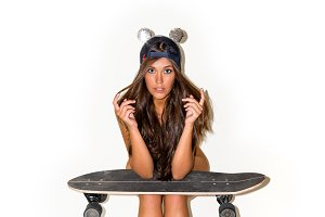 Young beautiful girl with longboard