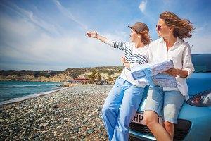 Happy traveling girlfriends