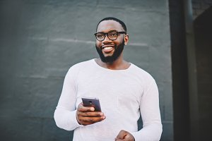 African American guy with smartphone