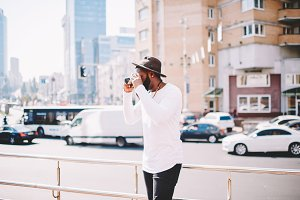 Tourist guy photographing city
