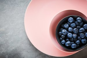 fresh blueberries in a pink Bowl on