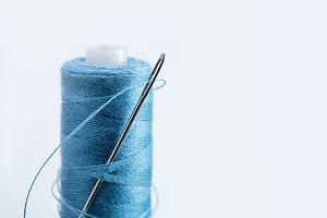 Needle in thread reel.