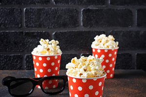 Popcorn with 3d glasses on dark