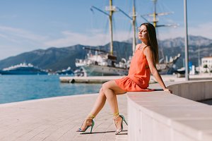young woman relax seashore with yach