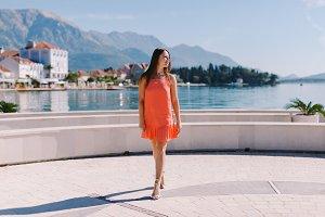 Woman Walking On Seaside Promenade