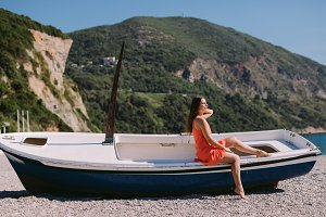 woman sitting on the beach in boat