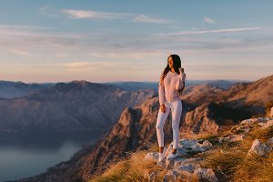 woman relax in mountains at sunset