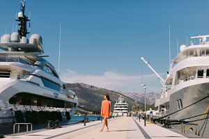 woman in sea port of yacht
