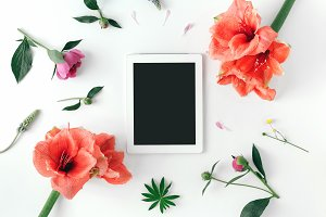 Flat lay white tablet desktop