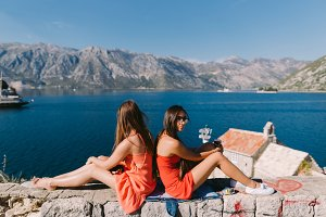 two girls relaxing on seashore with
