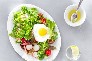 Plate fresh salad quinoa fried egg