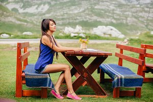 woman relax in cafe outdoors.