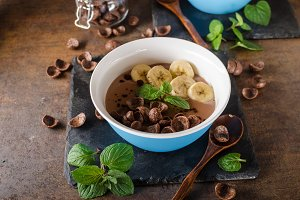 Chocolate pudding, banana and herbs