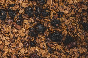 Granola baked in oven with nuts