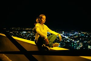 woman relaxing on rooftop of the bui