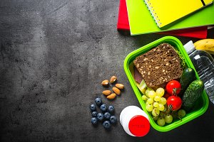 School lunch box and stationery on